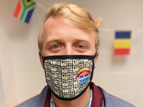 "Morgan Latimer poses with his new ""Something in the Water"" mask."