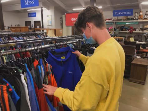 Junior Jacob Ritz browses some of the DAVs clothing racks.