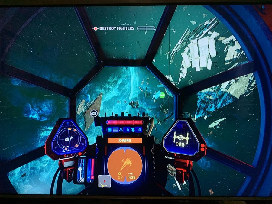 Gameplay showing the inside of the tie fighter cockpit as the player destroys enemy ships.
