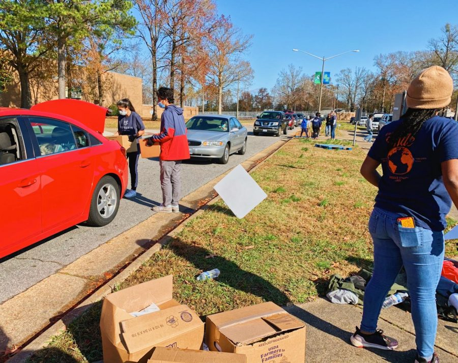 Food Rescue US volunteers help put USDA food boxes into the trunks of cars in the Green Run High School parking lot to help decrease food insecurity on Dec. 5.