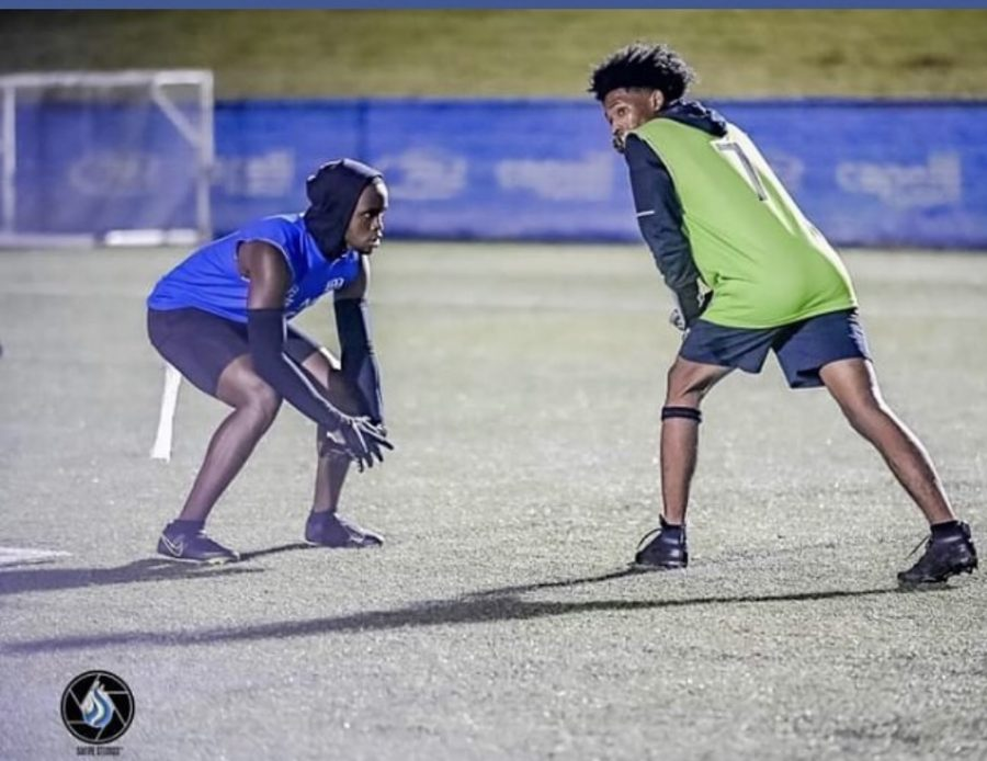 Carlton Winston (Blue) lines up against Jordan Cooper in the VB Hurricanes' 7v7 game against the Cox High School Green Machine on Oct. 5 at the Sportsplex.