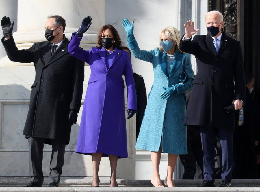 Newly inaugurated President Joe Biden and First Lady Jill Biden (right) wave next to Vice President Kamala Harris and her husband, Doug Emhoff. (left)