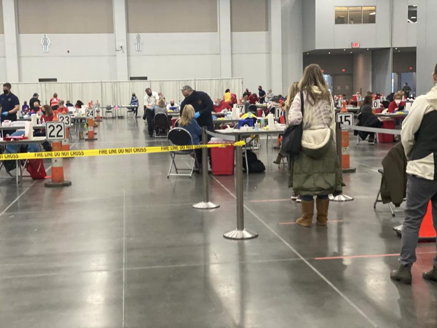 Math teacher Susan John and other Virginian residents stand in line to receive their second vaccination at the Virginia Beach Convention Center on Feb. 18.