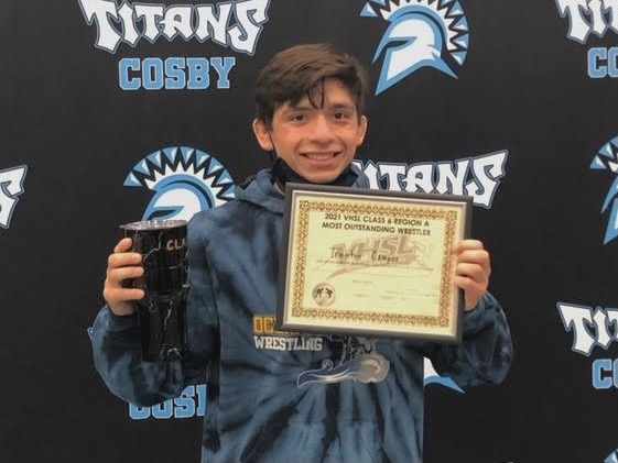 Trenton Campos beams while displaying his 'Outstanding Wrestler' award after regionals at Cosby High School on Feb. 15.