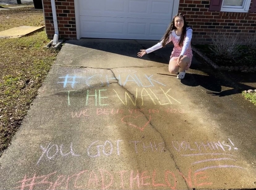 Senior Michelle Pham displays her chalk work for