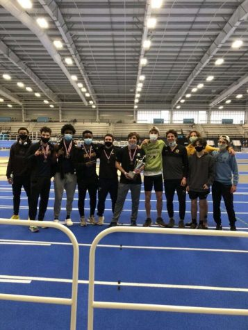 Boys Indoor Track Team (from left: Alex Blakely, Hayden Oglesby, Glen Skinner, Isreal Olukanni, Anderson Burns, Robbie Scornavacchi, Owen Lipps, Matthew Lanzilotta, Nate Bushy, Preston Haney, and Harrison Ladd) gathers to  present their first place victory trophy at the Virginia Beach Sports Center on Monday, Feb. 15.