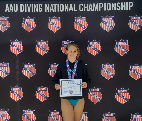 Sydney Soto poses with her medal and certificate after competing in the AAU Diving National Championship.