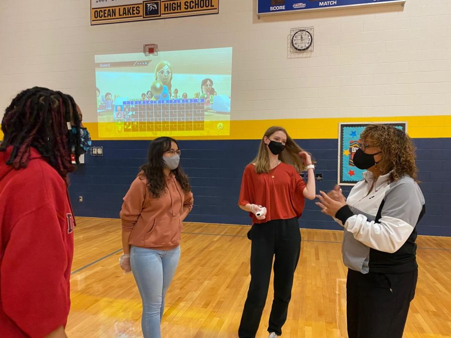 Mrs. Boothe instructs students during PE in the gymnasium.
