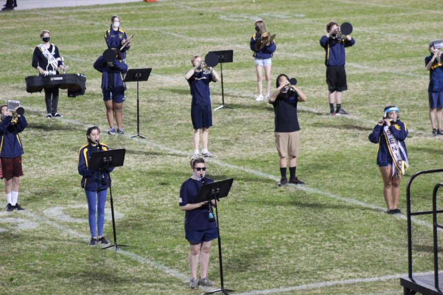The marching band performs during the senior night football game on March 26.