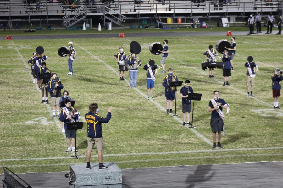 The marching band performs at the senior night football game on March 26.
