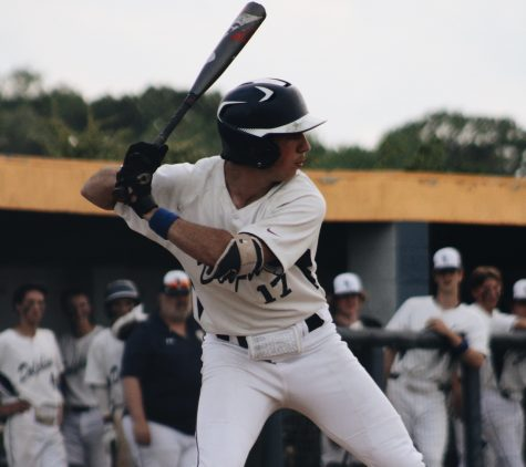 Senior Aidan Pinto lines up to bat in the bottom of the third inning at home on April 29.