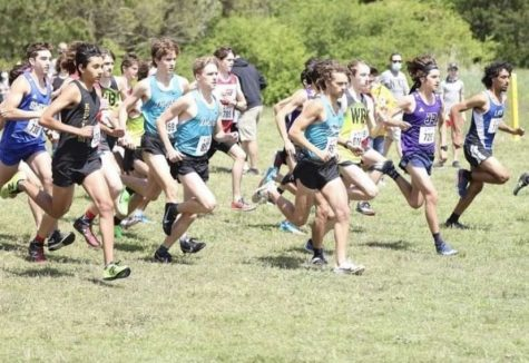 Photo of Harrison Ladd (RIght), Aidan Bolger (Middle), and Owen Lipps (Left) Racing in cross country 6A regional championship at Bells Mills April 17th, 2021.