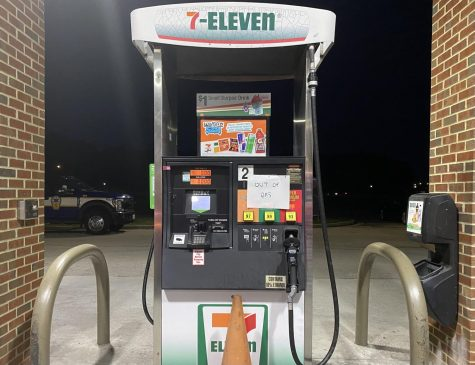 """Gas pump at 7/11 displays sign marked """"Out of gas"""" on May 13."""