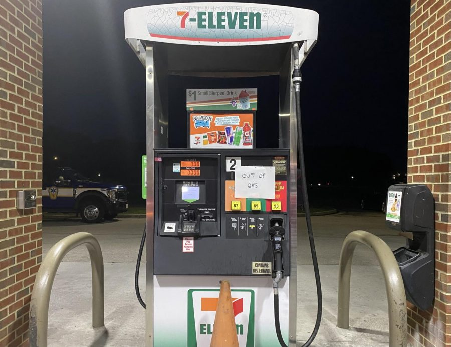 Gas pump at 7/11 displays sign marked Out of gas on May 13.