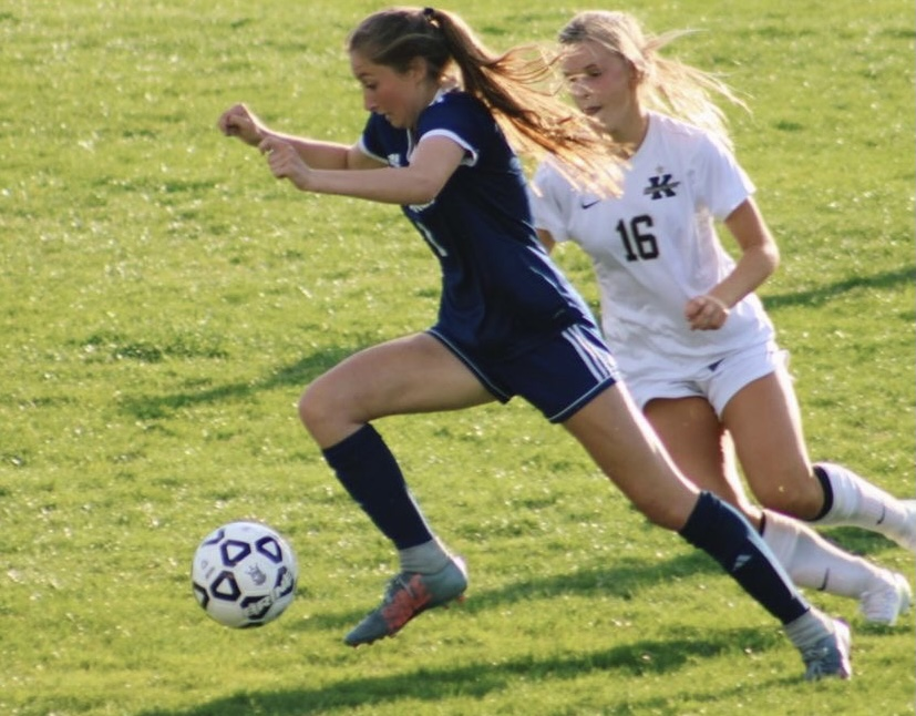 Senior Emerson Imbriale dribbles the ball down the field in the varsity soccer home opener against Kellam on April 30.