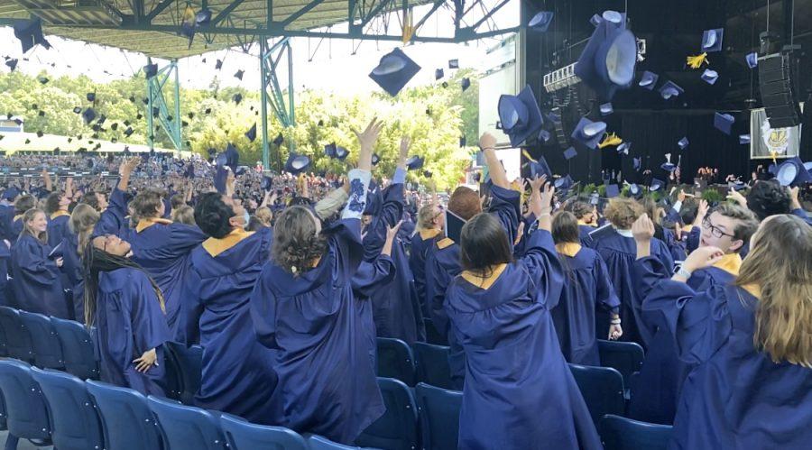 Senior class throws  caps into the air to end their graduation ceremony after Principal Claire LeBlanc announces them high school graduates.
