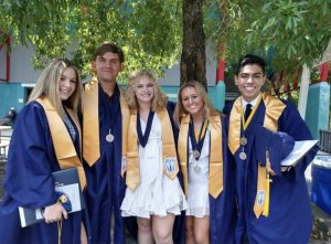 From right, two of ten medallion recipients, Reese Thornton and Alan Ledezma, wearing their medallions, stand with fellow graduates after their June 18 ceremony, held at the Virginia Beach Amphitheater.