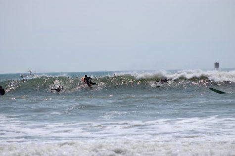 Local groms surf at Croatan Beach on May 24.