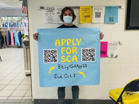 Senior, Gabriel Gonzales, advertises QR code for SCA General Assembly on Sept. 27 at Ocean Lakes High School.