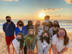 (Top row left to right) Logan Carolino, Allison Houpt, Chelsea Agyei, Caroline Camden, Justin Tran, (bottom row left to right) Ryan Smith, Isabelle Westlake, Lily Trinh, and Grace Mozingo who are a part of Class of 2022 Executive Board pose on 2nd street at the Oceanfront on Sept. 3.