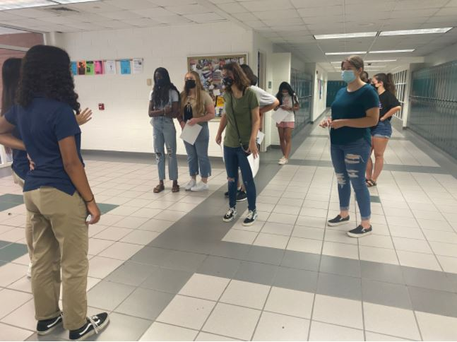 Students participate in the return to school building tour event on Sept. 1 at Ocean Lakes, guided by SCA students Naya Thompson and Ruoming Shen.