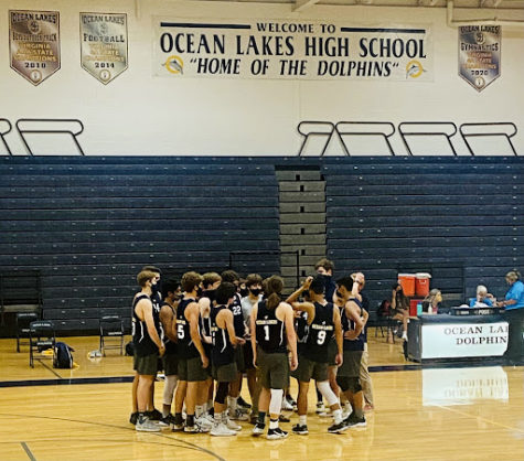 The Dolphins finish their second game with a 3-0 victory over Great Bridge on Wednesday, Sep. 8, at the Ocean Lakes High School Gymnasium. (Ryeligh Probst, Grade 12)