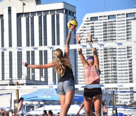 Riley knuckles the ball over the opponents hand securing a point at a tournament in Clearwater, Florida, on July 12, 2021.