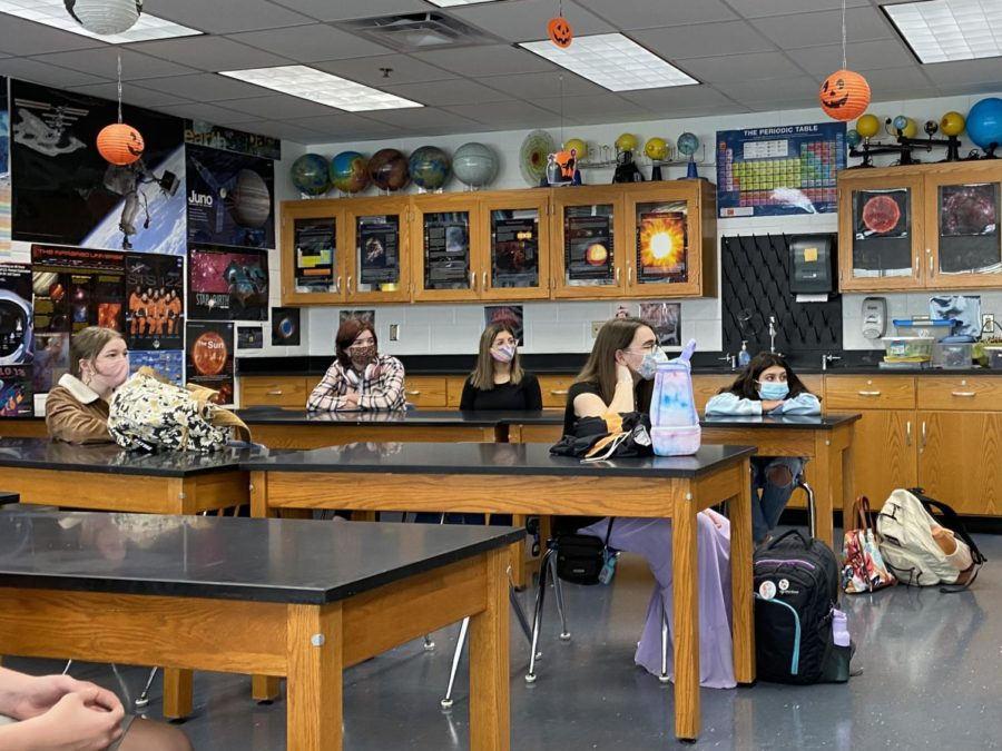 Astronomy club members attend their second meeting on Oct. 14 and learn about the Orionid meteor shower.